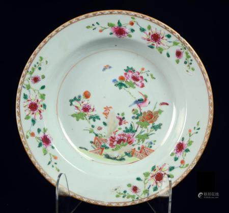 A Chinese famille rose soup plate with flowers, fence and bi