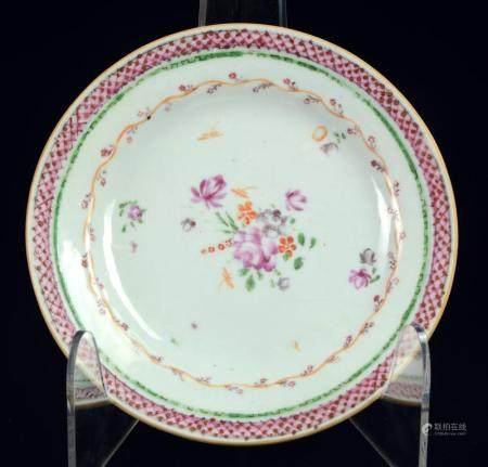 A Chinese famille rose small plate or saucer with flowers, l