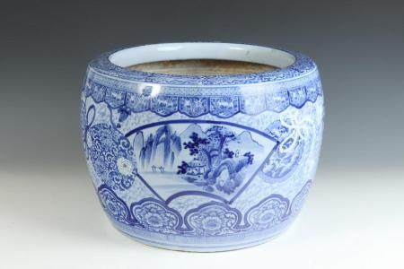 JAPANESE BLUE AND WHITE PORCELAIN PLANTER ON SEPARATE TEAKWO