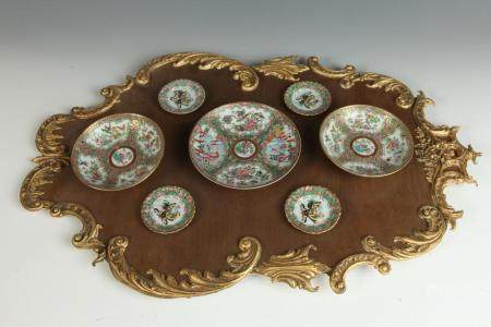 PARCEL-GILT WOODEN CARTOUCHE PLAQUE MOUNTED WITH SEVEN CHINE