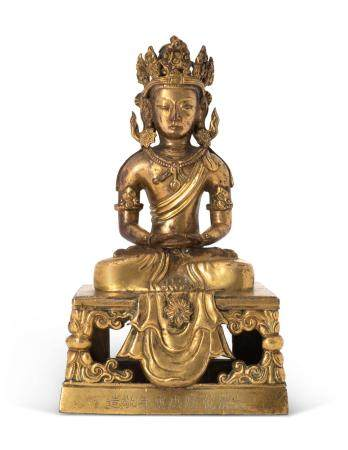 A CHINESE GILT-BRONZE FIGURE OF AMITAYUS