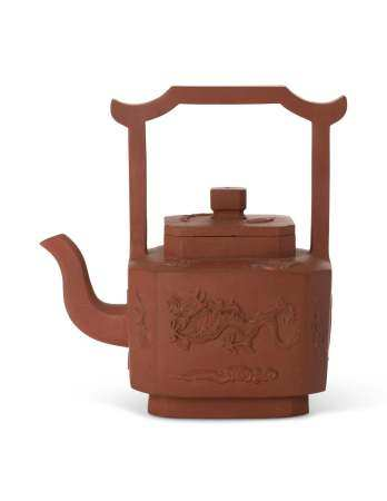 A CHINESE YIXING RED POTTERY TEAPOT