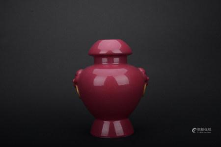 Qing dynasty red glaze beast ear bottle