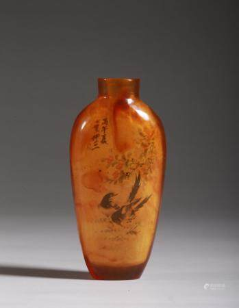 AN AMBER FLOWERS AND BIRDS SNUFF BOTTLE
