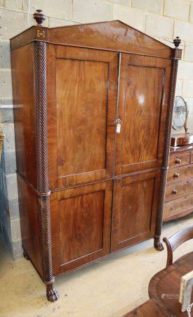 A Regency mahogany linen press, W.136cm, D.60cm, H.214cmCONDITION: The upper section interior