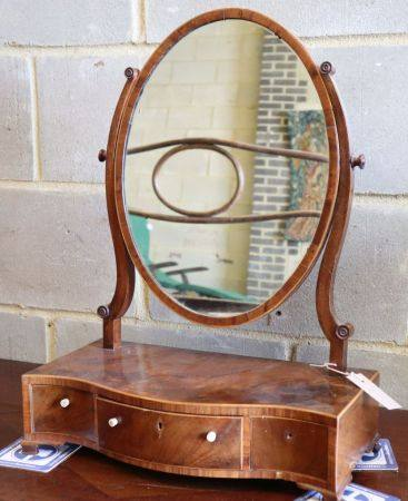 A George III mahogany and boxwood strung swing-frame toilet mirror, W.43cm, D.21cm, H.56cmCONDITION: