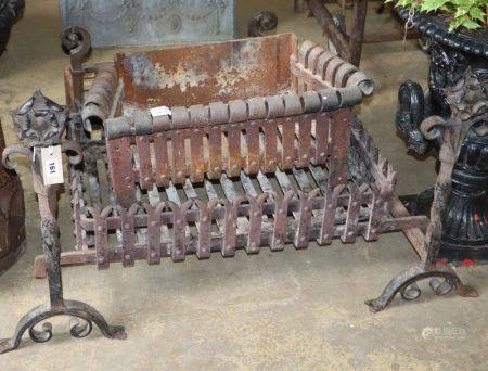 Three wrought iron fire baskets and a pair of dogs, largest basket W.70cm