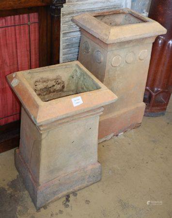 J M Blashfield, Stamford. Two buff chimney pots, c.1880, with roundel decoration, larger W.40cm, D.