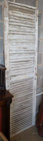 A set of four French original painted louvres shutters, c.1840, W.59cm, H.210cm