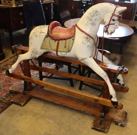 An early 20th century Ayres type carved wood dapple grey rocking horse on pine safety frame, H.