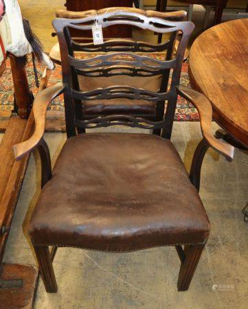 A pair of George III mahogany pierced ladderback elbow chairs