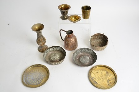 A small quantity of Middle Eastern metal ware, including a pair of copper bowls with repousse floral