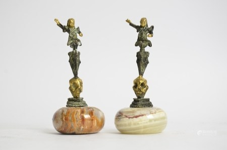 A pair of Chinese gilt metal bronzes raised upon onyx bases, height 14cm