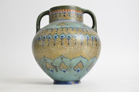 A Gouda pottery twin handled vase, retailed through Liberty of London, height 20cm (a/f)