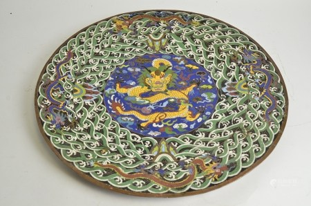 A Cloisonné charger of substantial proportions, with dragon and flaming pearl decoration, the