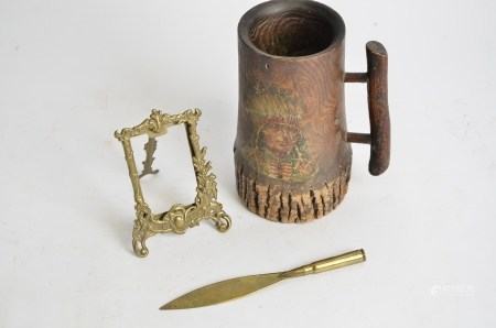 A WW1 trench art brass letter opener, together with a frame and native Indian tankard, height