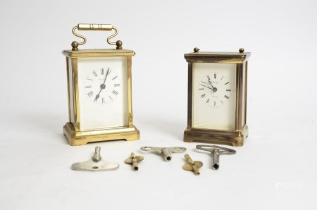 Two brass carriage timepieces, one marked 'Henley', the other 'Dominion', total height of tallest