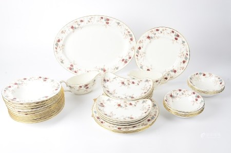 A extensive Minton dinner service in the 'Ancestral' pattern, to include dinner plates (32+),