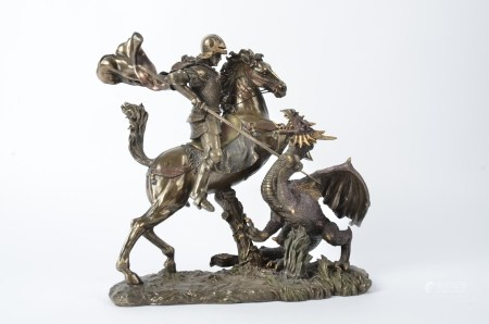 A resin model of St George and the dragon, height 27cm
