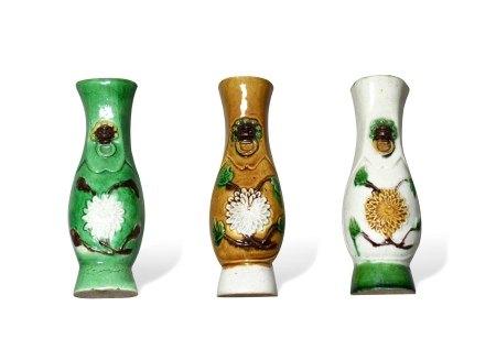 A Set of Three Biscuit-Glazed 'Chrysanthemum' Wall Vases, Kangxi Period, Qing Dynasty清康熙 菊纹壁瓶 一组三件
