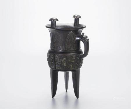 CHINESE BRONZE TRIPOD VESSEL WITH ARCHAISTIC PATTE