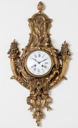 AN ORMOLU WALL CLOCK