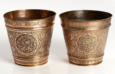 A NEAR PAIR OF DECORATIVE COPPER PLANTERS