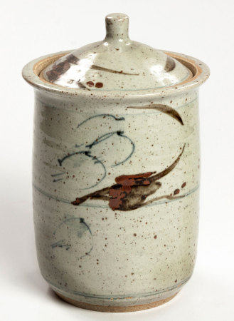 A TALL STONEWARE STORAGE JAR AND COVER