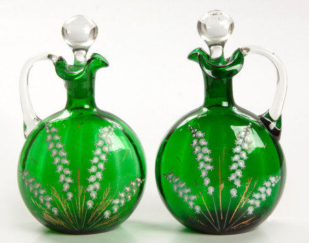 A PAIR OF VICTORIAN GREEN GLASS AND ENAMEL DECANTERS