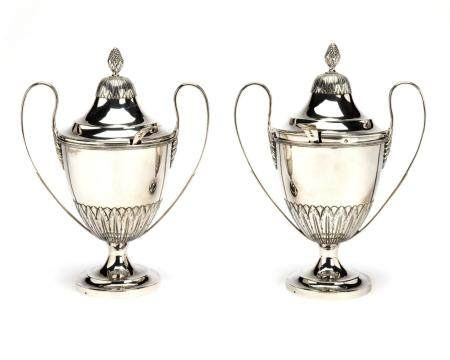Two Dutch silver chestnut vases, including two spoons