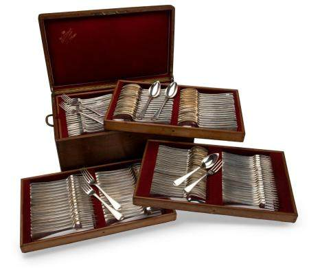 A wooden canteen with a collection of Dutch silver flatware