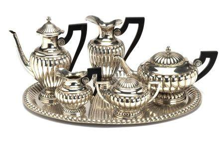 A silver five piece tea service and tray