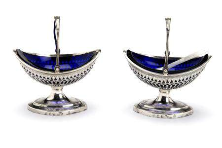 Two Dutch silver salt cellars with blue glass liners., The Hague