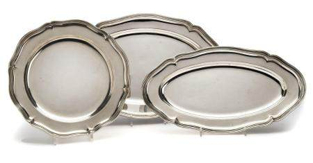 Three silver serving dishes