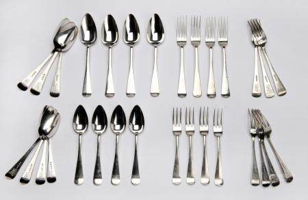 Twenty four Dutch silver table spoons and forks and twelve dessert spoons and forks