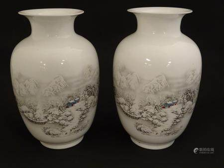 A pair of Chinese baluster vases with flared rims, with transfer decoration depicting winter