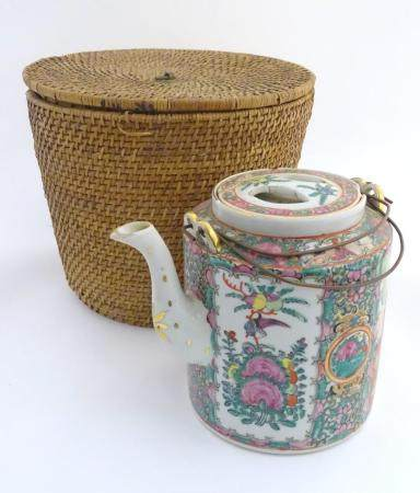 A Chinese Cantonese teapot and cover with famille rose decoration with panelled decoration depicting