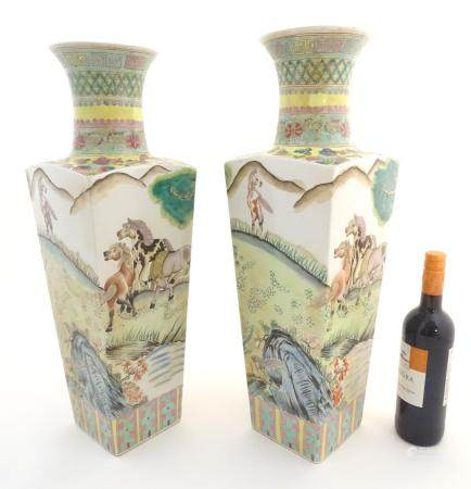 A pair of Chinese square sectional vases with flared rims, decorated with horses in a landscape