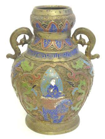 A brass Japanese vase of baluster form with Cloisonné decoration depicting a deity upon an animal
