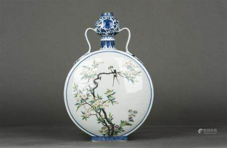 A Chinese underglaze Blue and Famille- rose Enameled Moon-Fl