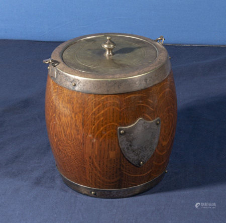 A silver plated wooden biscuit barrel