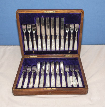 A twelve piece setting canteen of cutler with mother of pearl handles