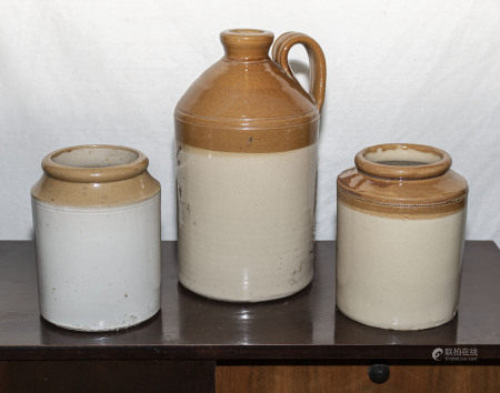 Two stoneware jars and a bottle