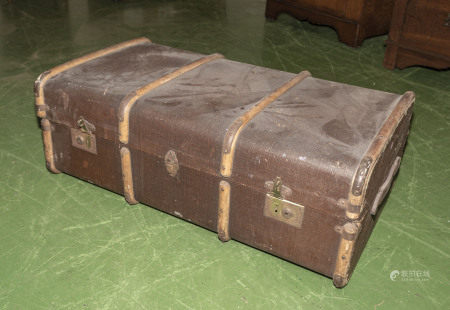 A large travel trunk