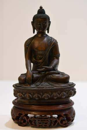 Bronze Seated Buddha on a Wood Stand
