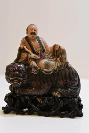 Carved Soapstone Seated Lohan seated on a Foo Lion
