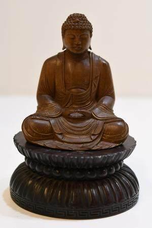 Carved sandel wood seated buddha