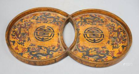 A 19th/20th century Chinese double circular wood and lacquer tray, length 42cm