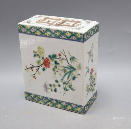 A Chinese famille rose pillow, late 19th century, height 15cmCONDITION: Generally a little worn to