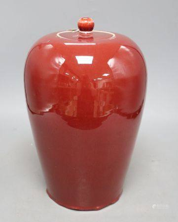 A 19th century Chinese flambe vase and coverCONDITION: Crazing visible throughout as well as other